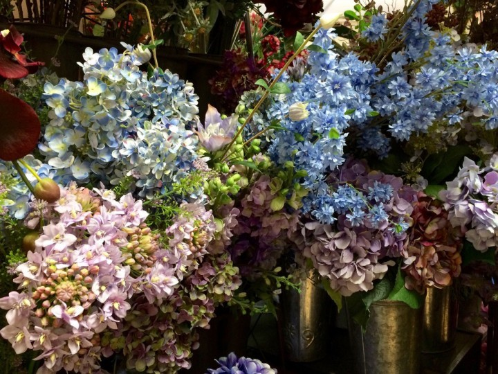 Collection of silk flowers in vases