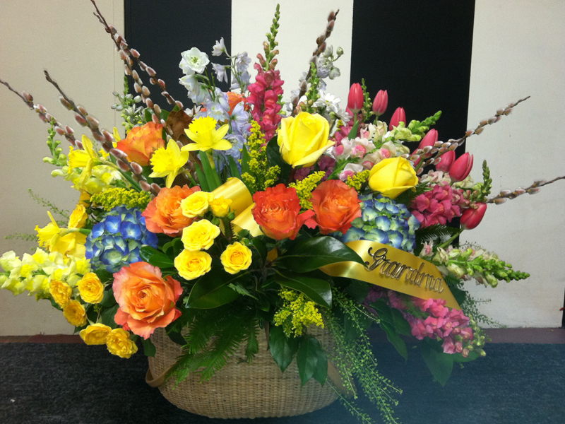 Red and yellow funeral floral arrangement