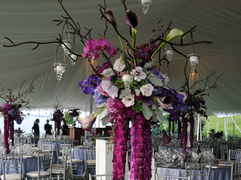 Flowers in tent at a Romantic style wedding