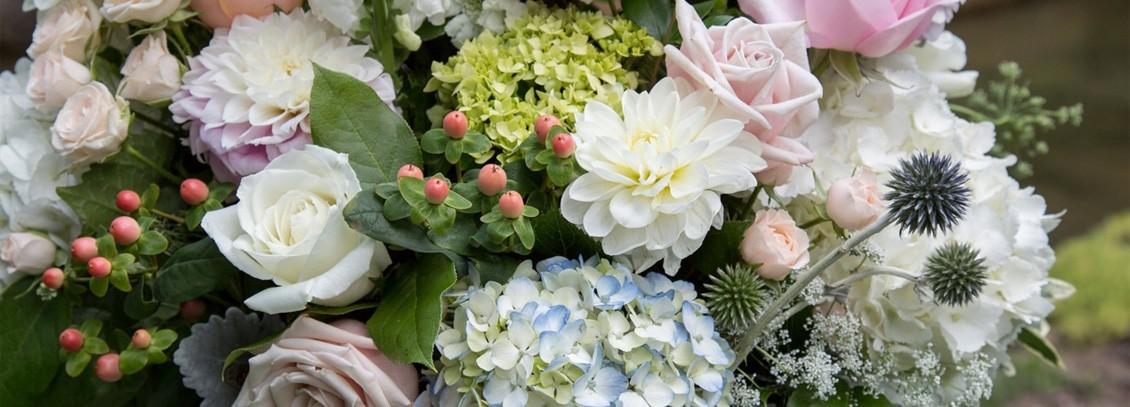 Floral arrangement of soft colored flowers