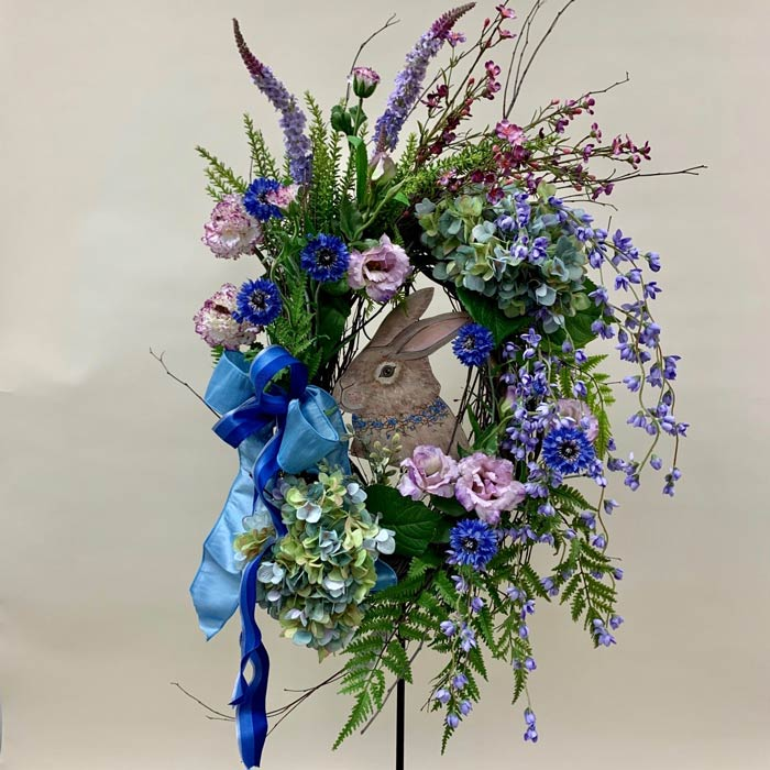 Easter wreath with silk flowers and bunny