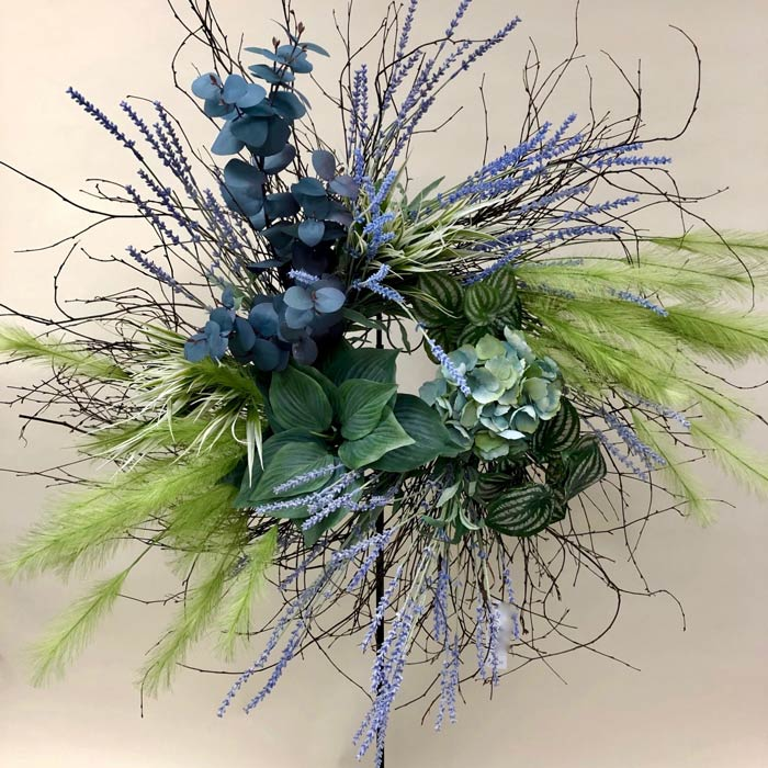 Wreath with delicate silk greens and flowers
