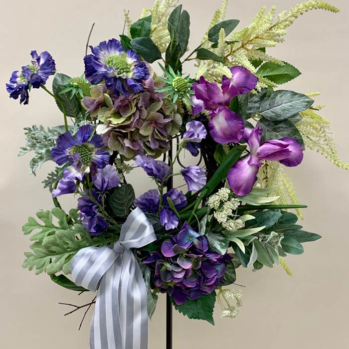 Silk flower wreath with ribbons