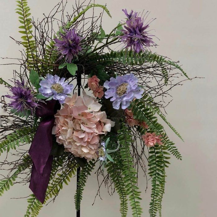 Silk flower wreath with purple and pink accents