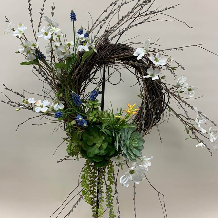 Silk flower wreath with spring blossoms